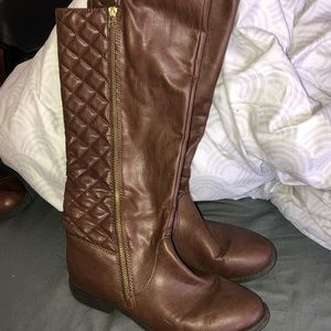tall brown boots !